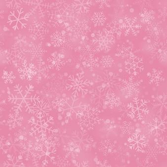 Boże narodzenie bezszwowe wzór płatków śniegu o różnych kształtach, rozmiarach i przezroczystości, na różowym tle