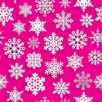Boże narodzenie bezszwowe wzór z białej księgi płatki śniegu na różowym tle