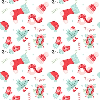 Boże narodzenie bezszwowe wzór z czerwone rękawiczki, skarpetki, czapki i słodkie zwierzaki kreskówek w ciepłe ubrania