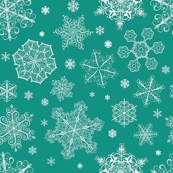 Boże narodzenie bezszwowe wzór z dużych i małych białych płatków śniegu na zielono-niebieskim tle