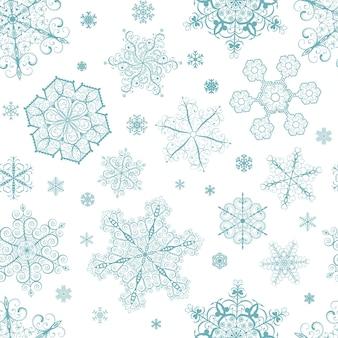 Boże narodzenie bezszwowe wzór z dużych i małych turkusowych płatków śniegu na białym tle