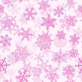 Boże narodzenie bezszwowe wzór ze złożonymi dużymi i małymi płatkami śniegu, różowy na białym tle