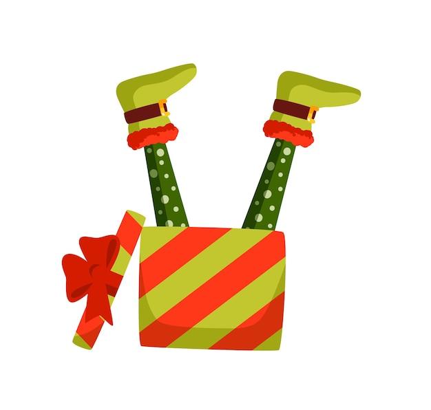 Boże narodzenie elf nogi i ilustracja pudełko. leprechaun, postać z kreskówki pomocnika świętego mikołaja. noworoczny prezent, bajkowe elfie stopy w wakacyjnym opakowaniu na białym tle.