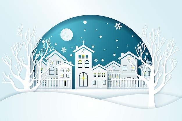 Boże narodzenie i city village ze śniegiem w sezonie zimowym.