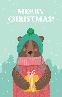 Boże narodzenie ilustracja karty z pozdrowieniami niedźwiedź z prezentem