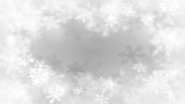 Boże narodzenie rozmyte tło z ramą złożonych, rozmytych dużych i małych płatków śniegu w biało-szarych kolorach z efektem bokeh