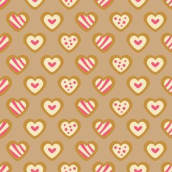 Boże narodzenie słodycze piekarnia wzór z pierniki serca ciasteczka. wakacje jesienno-zimowe. tapeta, druk, opakowania, papier, projektowanie tekstyliów. jeden z 20