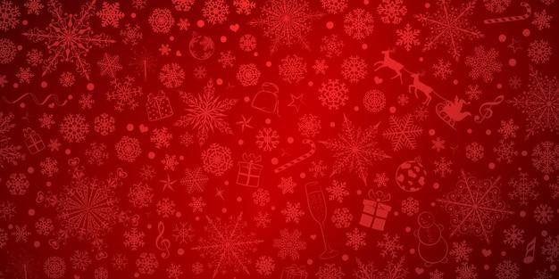 Boże narodzenie tło różnych płatków śniegu i świątecznych symboli, w czerwonych kolorach