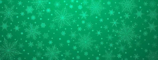 Boże narodzenie tło różnych złożonych dużych i małych płatków śniegu, w zielonych kolorach