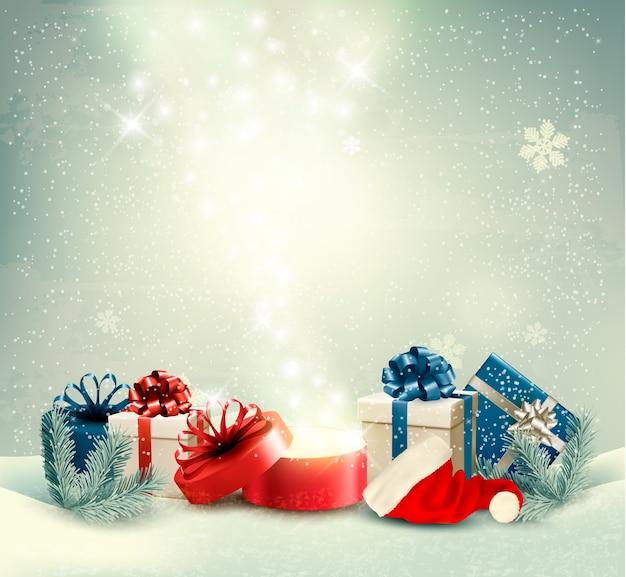 Boże narodzenie tło wakacje z prezentami i magiczne pudełko.