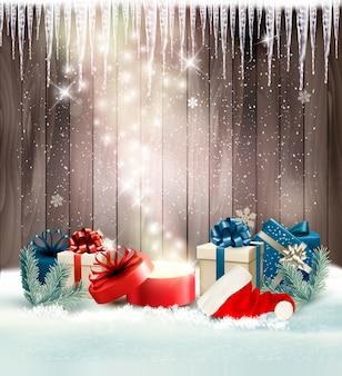 Boże narodzenie tło wakacje z prezentami i magiczne pudełko