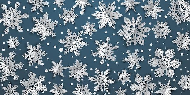 Boże narodzenie tło z objętościowymi płatkami śniegu z miękkimi cieniami na niebieskim tle