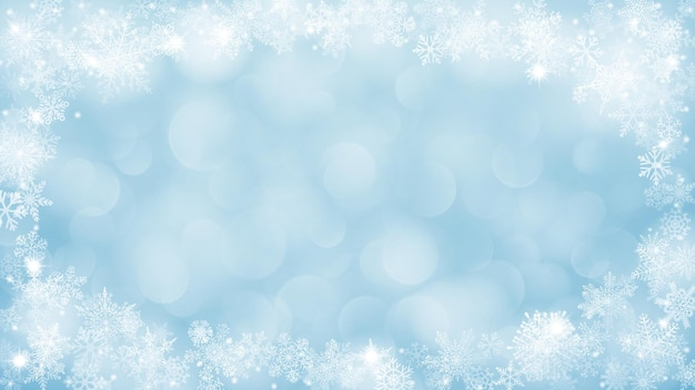 Boże narodzenie tło z ramą płatków śniegu w kształcie elipsy w jasnoniebieskich kolorach i z efektem bokeh