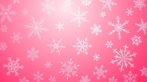 Boże narodzenie tło z różnymi złożonymi dużymi i małymi płatkami śniegu w różowych kolorach