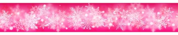 Boże narodzenie transparent złożonych niewyraźne i jasne płatki śniegu w białych kolorach na różowym tle. z powtórzeniem poziomym