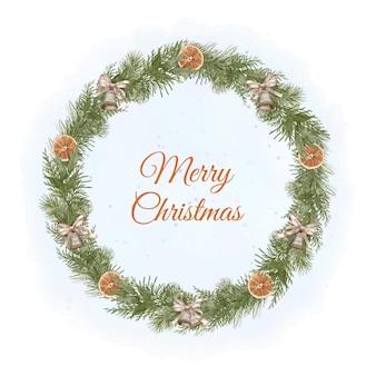 Boże narodzenie wieniec z drewna boho z gałązkami sosny, dzwonkami i plasterkami pomarańczy