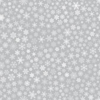 Boże narodzenie wzór małych płatków śniegu, biały na szarym