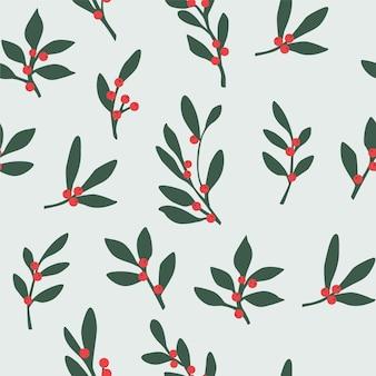Boże narodzenie wzór z liści i czerwonych jagód.