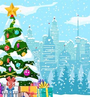 Boże narodzenie zima gród, płatki śniegu i drzewa. aleja śnieżna w parku miejskim i budynki.
