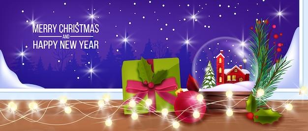 Boże narodzenie zima tło ze szklaną kulą śniegu, okno, pudełko, girlanda światła, gałąź jodły. baner świąteczny i szczęśliwego nowego roku z prezentami, szklana kula zabawkowa. święta bożego narodzenia