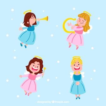 Bożenarodzeniowa anioł kolekcja w błękitnych i różowych sukniach