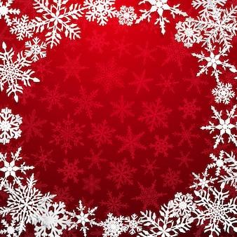 Bożenarodzeniowa ilustracja z okrągłą ramą dużych białych płatków śniegu z cieniami na czerwonym tle