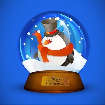 Bożenarodzeniowa śnieżna kula ziemska z pingwinem