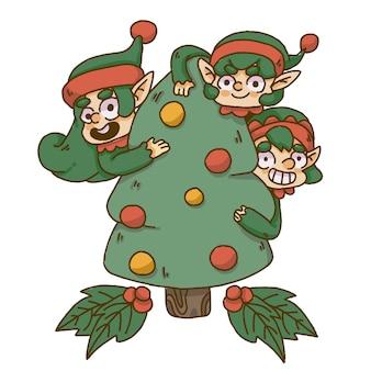 Bożenarodzeniowe elfy chuje się za choinką