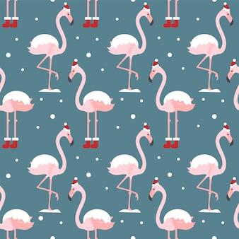Bożenarodzeniowy bezszwowy wzór z flamingiem i śniegiem.