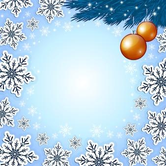 Bożenarodzeniowy błękitny tło z płatkami śniegu i złotymi baubles