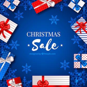Bożenarodzeniowy sprzedaży tło z prezentami