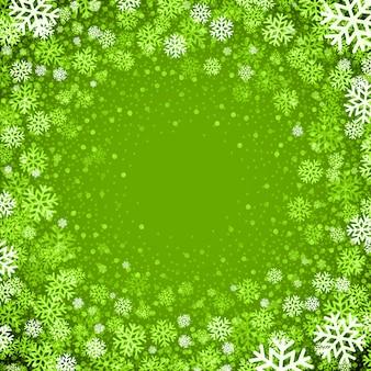 Bożenarodzeniowy tło płatki śniegu w zielonych kolorach