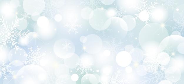 Bożenarodzeniowy tło projekt płatki śniegu i bokeh światła