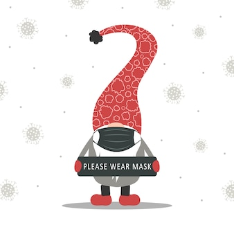Bożonarodzeniowy krasnal w masce medycznej trzyma plakat. koronawirus epidemiczny.