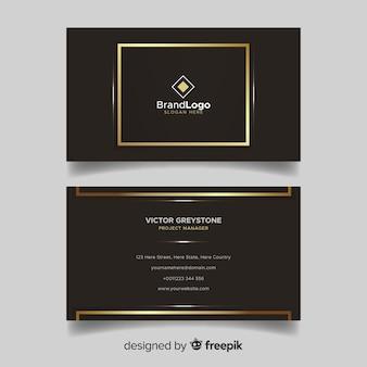 Brązowa i złota wizytówka z logo