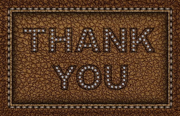 Brązowa skórzana oprawka z napisem dziękuję ze srebrnymi cekinami.