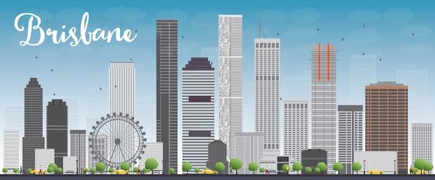 Brisbane linia horyzontu z szarym budynkiem i niebieskim niebem