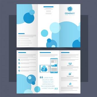 Broszura tri-fold firmy, ulotka z niebieskimi okręgami.