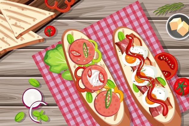 Bruschetta z warzywnymi składnikami na drewnianym stole w tle