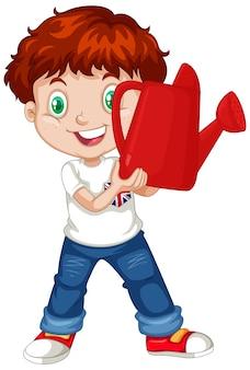Brytyjski chłopiec trzyma czerwoną konewkę