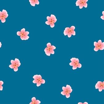 Brzoskwiniowy kwiat bez szwu na niebieskim tle indygo