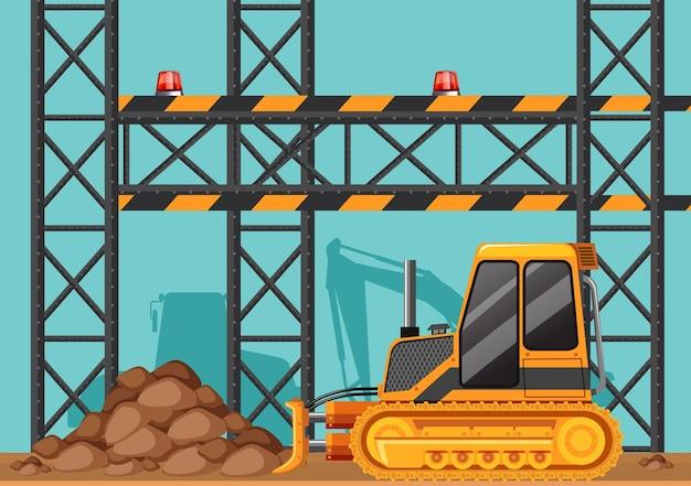 Budowa z buldożer i metal bary