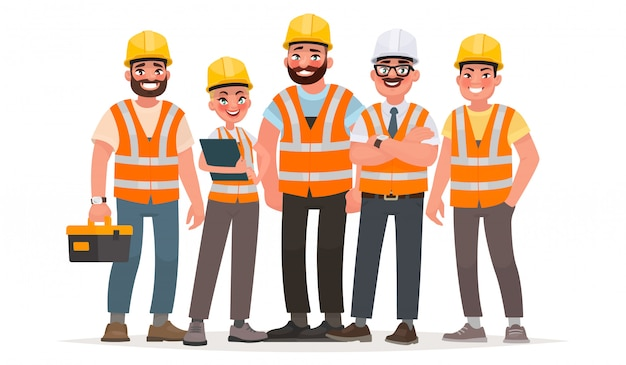 Budowniczowie ubrani w kamizelki ochronne i kaski. pracownicy na budowie