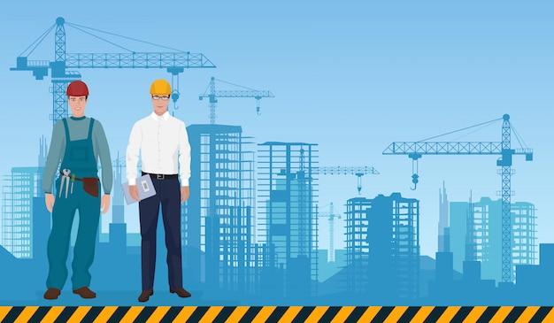 Budowniczy i kierownik na tle budowy