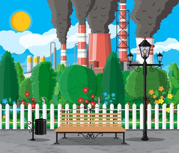 Budynek fabryczny i park miejski. fabryka przemysłowa, elektrownia. rury, budynki, magazyn, zbiornik magazynowy. pejzaż miejski z chmurami, drzewami i słońcem. ilustracja wektorowa w stylu płaski