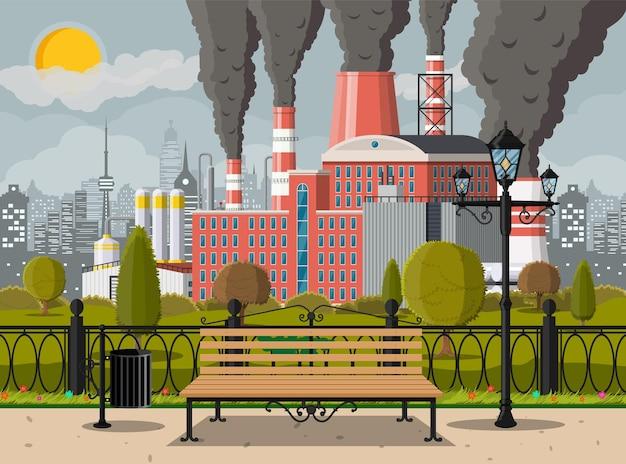 Budynek fabryczny i park miejski. fabryka przemysłowa, elektrownia.