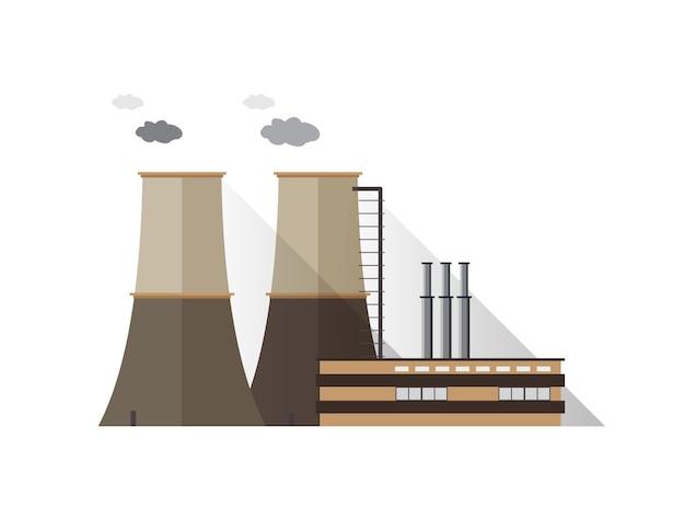 Budynek fabryczny z izolowanymi rurami i wieżami chłodniczymi emitującymi opary