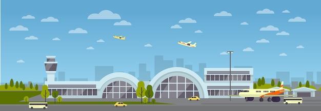 Budynek lotniska. duży nowoczesny terminal lotniczy z oknem szklanym. startujące samoloty.