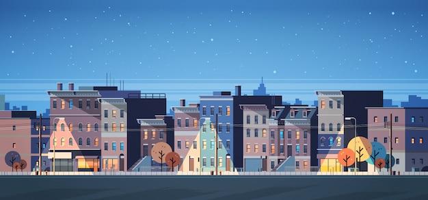 Budynek miasta domy noc widok panoramę transparent