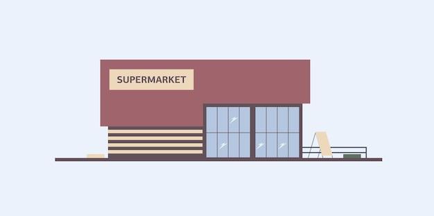 Budynek sklepu spożywczego z dużymi witrynami zbudowany w nowoczesnym stylu architektonicznym